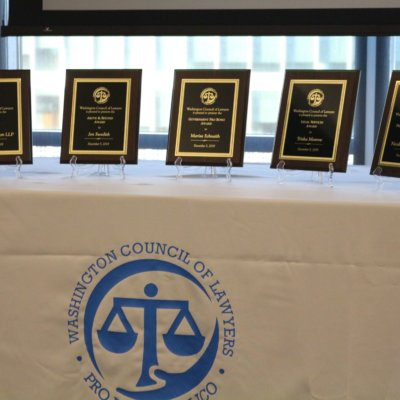 5 Award Plaques On A Table